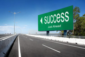 road with sign of success conceptual image